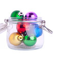 New year bright color decoration ball in glass can over white Stock Photo