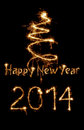 New year card written with sparkles on dark background Royalty Free Stock Photo