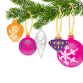 New Year or Christmas background. Fir tree branch with toys of different shapes