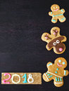 New Year and Christmas background. Gingerbread cookies are framing the background Royalty Free Stock Photo