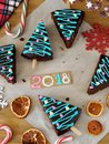 New Year 2018. Christmas pastry, candies and decorations Royalty Free Stock Photo