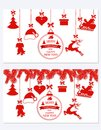 New Year Christmas. Set different hanging ornaments Santa hat, deer, heart, gift, dog and Christmas tree isolated on Royalty Free Stock Photo