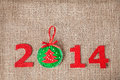 New year with christmas toy from felt on sackcloth background Royalty Free Stock Photo