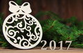 New year 2017,Christmas-tree decoration with a branch of a fir-tree and wooden figures of the coming year, Royalty Free Stock Photo