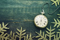 New year clock. Old pocket watch on a wooden background. Royalty Free Stock Photo