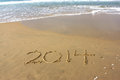 New Year 2014 is coming concept written on beach sand Royalty Free Stock Photo