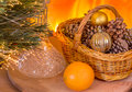 New year composition on the background of fire place christmas with a carafe basket and orange a Stock Photos