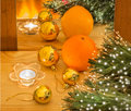 New year composition with orange and gold christmas balls their reflection in the mirror Stock Photo