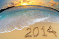 New year digits on beach sand ocean Stock Photos
