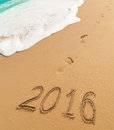 New year digits written on beach sand sunset Royalty Free Stock Image