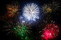 New year fireworks on the sky display over dark Royalty Free Stock Images