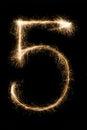 New year font sparkler number five on black background