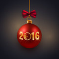 New Year greeting card, postcard, decorative red bauble with golden text 2016 and monkey symbol Royalty Free Stock Photo