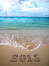 New Year 2015 is lined with pebbles on the beach. Royalty Free Stock Photo