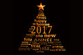 2017 new year multilingual word cloud greeting card in the shape of a christmas tree