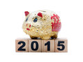 New year piggy bank and building blocks isolated on white Royalty Free Stock Image
