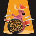 New Year`s card with a funny dog playing on drums Royalty Free Stock Photo