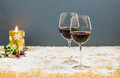 New year's eve cheers with two glasses of red wine and grapes Royalty Free Stock Photo