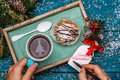New Year`s photo of tea with the image of Christmas tree, cake