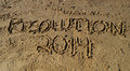 New year s resolution written in sand the words on the beach Stock Images