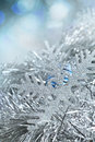 New year snowflake in tinsel and spangles christmas decorations Royalty Free Stock Photography
