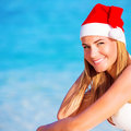 New year vacation on maldives happy blond girl enjoying wearing red santa hat travel to exotic country winter holidays Royalty Free Stock Images