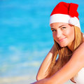 New year vacation on maldives happy blond girl enjoying wearing red santa hat travel to exotic country winter holidays copy space Royalty Free Stock Photos