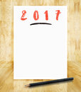 2017 new year on white paper frame with pencil in hand brush sty Royalty Free Stock Photo