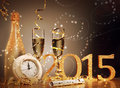 New years eve celebration background with an elegant arrangement with a clock counting down to midnight flutes and bottle of Stock Image