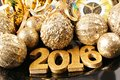 New Years Eve 2016 golden numbers and decorations Royalty Free Stock Photo