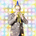 New years eve man celebrating at a countdown party creative portrait of dorky blowing celebration horns special occasion Royalty Free Stock Photos