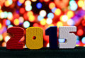 New Years numerals 2015 on a background of lights Royalty Free Stock Photo