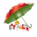New years red green umbrella with gifts and snowflakes Royalty Free Stock Photography