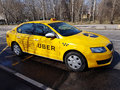 New yellow taxi with Uber logo Royalty Free Stock Photo