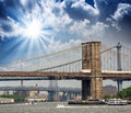 New york brookyn bridge and manhattan skyline at summer sunset Stock Images