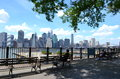 New york city benches in the shade on the brooklyn heights promenade offer views of manhattan and harbor Stock Photography