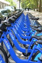 New york city bike share program has launched a sharing with bikes to rent at kiosks at numerous locations around town rows of Royalty Free Stock Photo