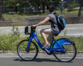 New york city citibikes woman riding one of s Royalty Free Stock Image