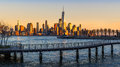 New York City Financial District skyscrapers and Hudson River at sunset Royalty Free Stock Photo