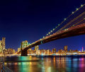 New York City Manhattan Bridge over Hudson River with skyline after sunset night view illuminated  l Royalty Free Stock Photo