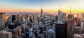 New York City. Manhattan downtown skyline with illuminated Empire State Building and skyscrapers at sunset. Royalty Free Stock Photo