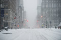 New York City Manhattan Midtown street under the snow during snow blizzard in winter. Empty 5th avenue with no traffic Royalty Free Stock Photo