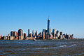 New york city manhattan view from water and blue sky Royalty Free Stock Photos