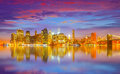 New york city night panorama with brooklyn bridge and illuminated reflections of downtown manhattan business and residential Royalty Free Stock Images