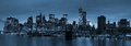 New york city at night panoramic view manhattan downtown skyline with skyscrapers and blue tonality Stock Images