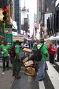 New york city, 12 september 2015: cleaners in green outfit on br Royalty Free Stock Photo