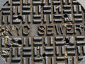 New York City Sewer Cover Royalty Free Stock Photo