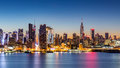 New york city skyline at dawn as viewed from weehawken along the nd street canyon Stock Photo