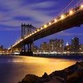 New york city skyline and manhattan bridge at night Stock Photo