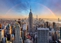 New York City skyline with urban skyscrapers and rainbow.
